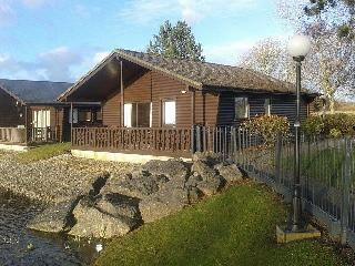 Lakeside lodge with stunning views including pool, Carnforth