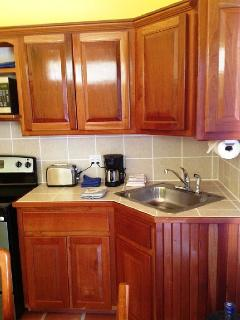 The kitchen includes microwave, toaster, blender and all the necessary pots and pans.