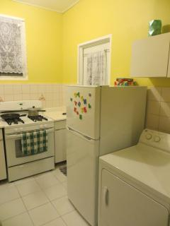 Kitchen is newly equipped with microwave, toaster oven, coffee maker, full stove with oven, full ref