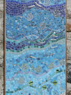 Artwork alongside the double doors - one of the owner's own mosaics.