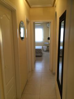 hallway between bedrooms with the 2 bathrooms