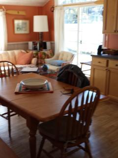 The Great Room with dining table looking to the French doors to the deck.
