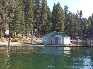 Floating cabin with private beach and dock