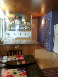 Full size fridge/freezer with water dispenser.