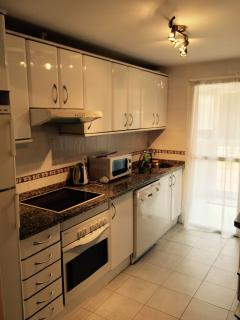 Fully kitted kitchen, leading out to utility room and out to poolside terrace.