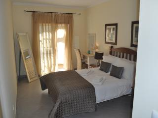 Stunning master bedroom with comfortable king size bed, dressing table, mirror and fitted wardrobes