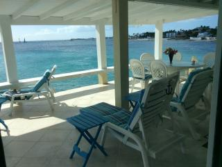 Amazing wrap views of the sea w/ boats,waves,sunsets. My deck -- a favourite spot for all!