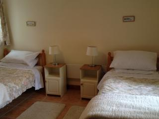 Bedroom One - Two Singles or one Super King Bed. Electric Blankets and cosy Eiderdowns.