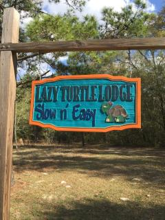 Entrance sign to Lazy Turtle Lodge estate