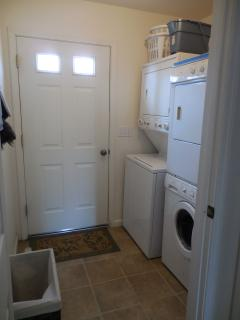 Laundry with 2 washers and 2 dryers for guests to use