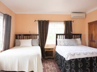 Big bedroom - 1 Queen and 1 Double bed