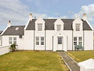 TIGH DHOMHNAILL, stone-built, king-size bed, lawned garden, beach within
