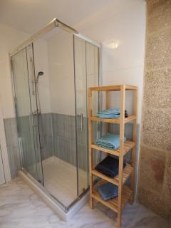 New bathroom with walkin shower and exposed stone