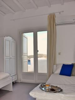 Bedroom with two single beds and sea view