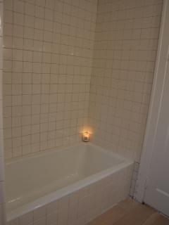 Upstairs shared bathroom. Nice & simple with large soaking tub.