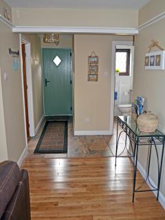 Walk through the door to a warm welcome in the open-plan hallway/lounge