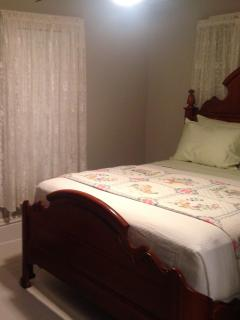 Suite three with Queen size bed, gas fireplace, and private bath with five foot shower.
