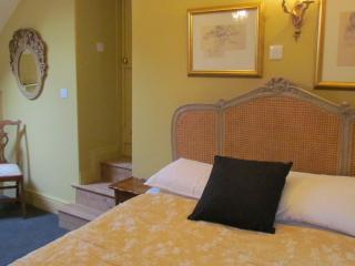 Coach House Bedroom with very comfy king size bed.decorated in soothing colours