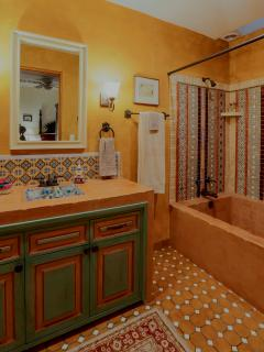 Bathroom with Tub/shower and Iridescent tile