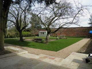 The walled garden with seating for 12 and the use of a BBQ