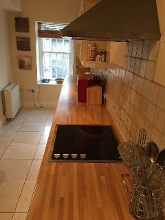 Galley Kitchen, with appliances such as Oven, grill, microwave, washing machine and dish washer.