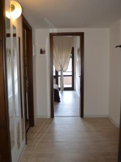 Large hallway between the bedrooms and the bathrooms.
