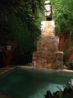 Plunge pool and fountain in the evening