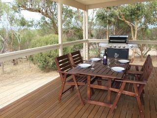 Outdoor dining and BBQ on the covered deck.