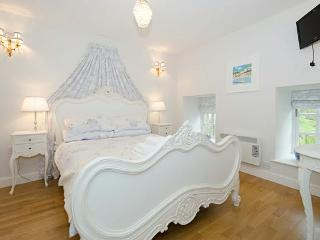 The lovely master bedroom with a French Style feature double bed en-suite