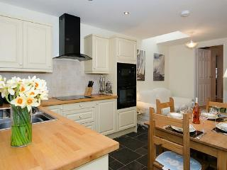A modern well equipped kitchen fitted with high quality appliances