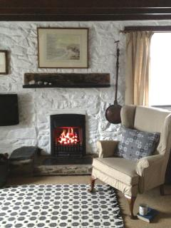 Come and snuggle up beside the fire in the spacious living room with a good book.