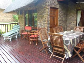 Spacious decked patio with comfortable outdoor furniture