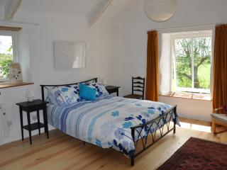 The stunning master bedroom with king size bed and beautiful countryside views.
