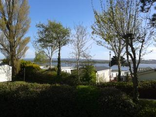 Two bedroom caravan in Poole with sea views.  Sleeps 6.  Parking and garden