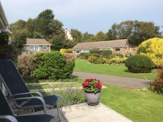 Relax on the front patio whilst looking out to sea or at the Green in front of the bungalow