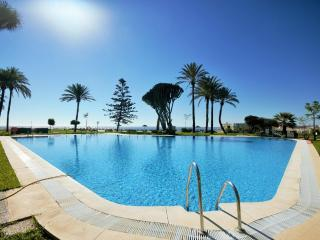 Pool in exotic gardens with panoramic sea views