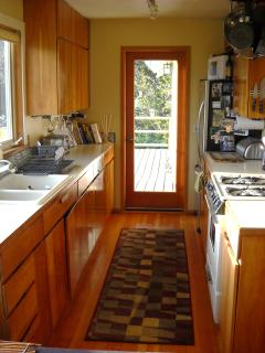 Farmhouse kitchen w/ access to covered patio and grill