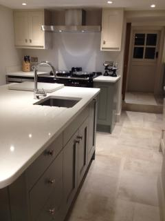 Bespoke kitchen featuring a new AGA, stone tiled floors, utility room with washer/dryer