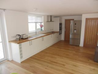 Kitchen with wooden work tops and big family fridge