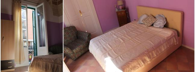 raffinata suite matrimoniale con balconcino che si affaccia su Viale Lo Re, dotata di cassaforte.