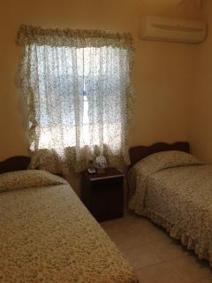 Bedroom 2...air conditioner with 2 twin beds