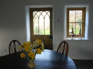 Kitchen opens to a garden and yard, a slate table and seats outside are perfect for breakfast.