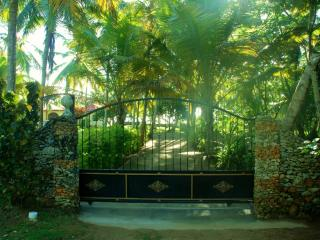 The caretaker's cottage is just outside the sliding gate at the entrance to the villa.