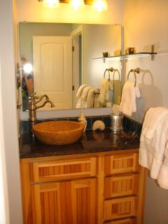 Modern  cozy 3/4 bath with all towels and paper products provided, also hair tools.