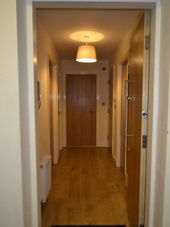 Main entrance hallway with full length mirror.