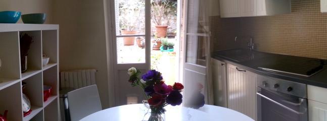 modern kitchen leading onto garden
