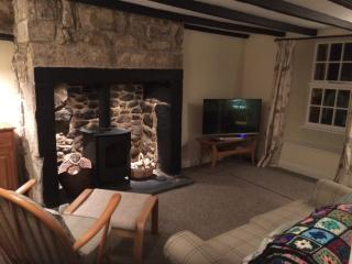 Inglenook fireplace with wood burning stove.