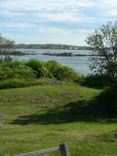 From the sitting room and deck, you can see lobster boats come into the cove for their traps.