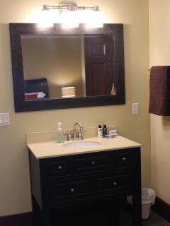 Full size vanity outside of bathroom