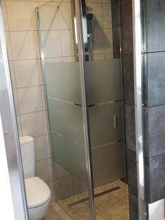 With shower and toilet